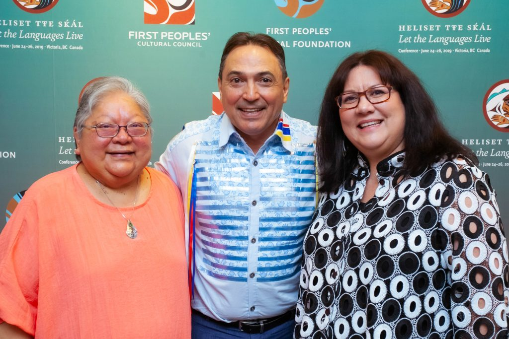 Chief Perry Bellegarde of the National Assembly of First Nations in between Lorna Williams and Karen Aird from the First Peoples' Cultural Foundation and the First Peoples' Cultural Foundation